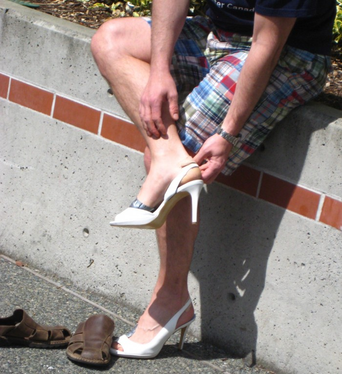 Men come out to walk-a-mile in her shoes