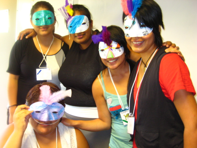 Some Gurlz from the Gurlz Club display their mask art.