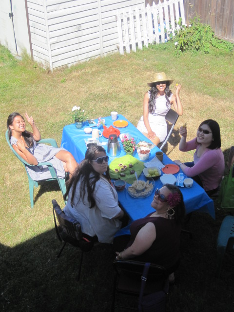 The antidote crew enjoying some sun and shade with their tea and treats!