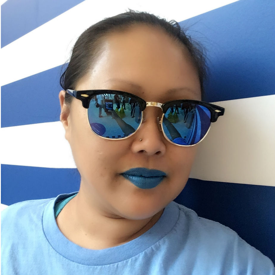 Judy Woo with blue shirt, blue lipstick, blue tint sunglasses, downtown Victoria.